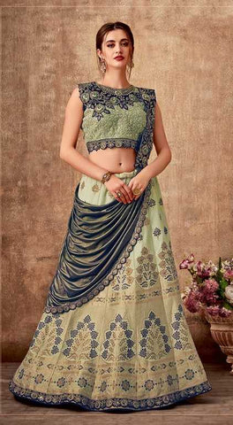 Green Weaved Silk Party Wear Lehenga With Green Choli And Blue Dupatta