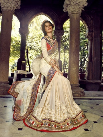 Such a fasinating white color saree with heavy border and contrasting blouse, fabric pallu of bembreng and base of bembreng Georgette along with georgette blouse