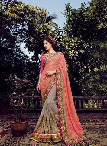 Designer bridal saree with such a heavy work on blouse and on ghera, a net pattern pallu of orange color , base of net and blouse of art silk cloth