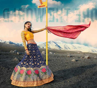 Blue Silk Party Wear Lehenga With Yellow Choli And Pink Dupatta