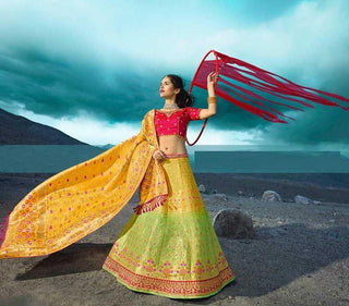 Green Silk Party Wear Lehenga With Yellow Choli And Pink Dupatta
