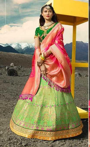 Green Silk Party Wear Lehenga With Green Choli And Pink Dupatta