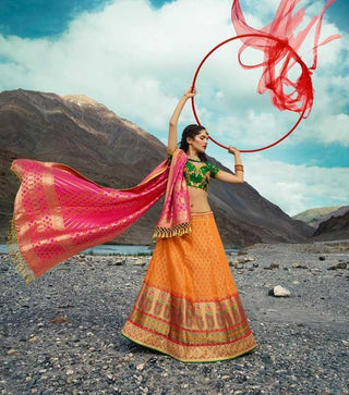 Orange Silk Party Wear Lehenga With Green Choli And Pink Dupatta
