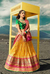 Yellow Silk Party Wear Lehenga With Green Choli And Pink Dupatta
