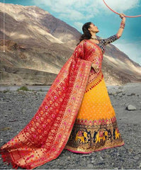 Yellow Silk Party Wear Lehenga With Blue Choli And Red Dupatta