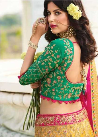 Yellow Silk Party Wear Lehenga With Green Choli And Magenta Dupatta