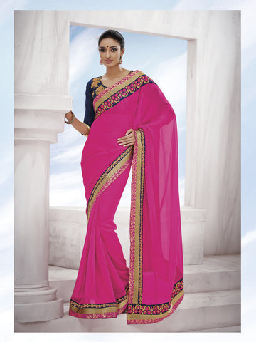 Magenta pink georgette saree  with work on voilet color blouse