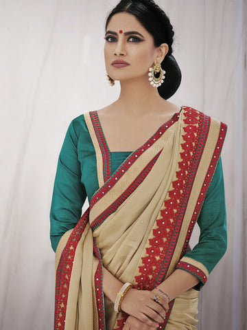 Cream color saree with contrasting border of red and blouse of green