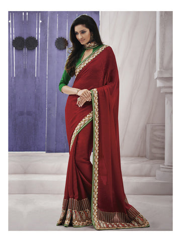 Red saree with heavy border and contrasting green blouse
