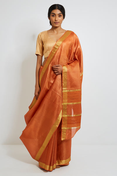 Via East orange handloom pure tissue silk saree with gold zari border and pallu