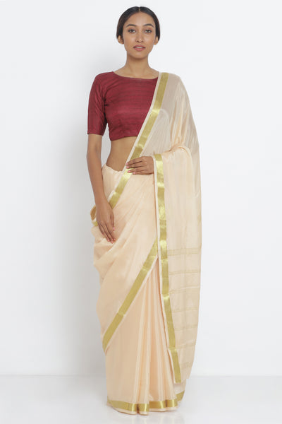 Via East light peach pure crepe saree with gold zari border