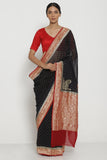 Black Handloom Pure Silk-Georgette Banarasi Saree with All Over Intricate Gold Zari Motifs and Contrasting Border
