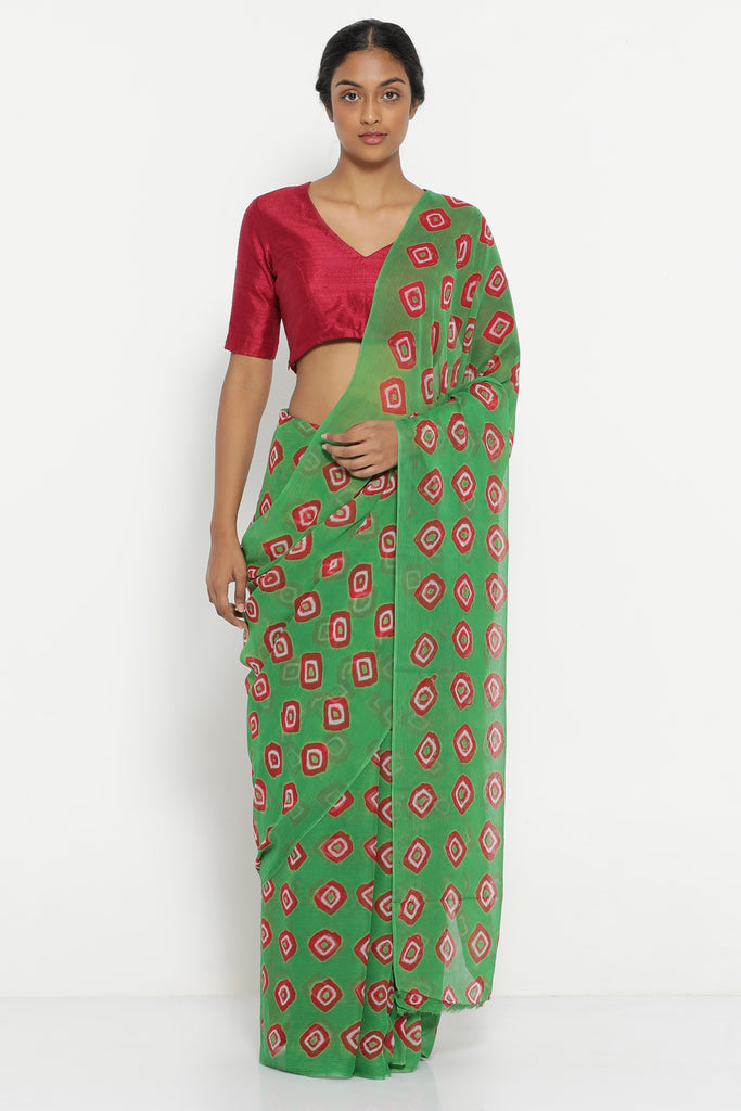 Green Chiffon Saree with All Over Traditional Bandhini Print and Striking Blouse