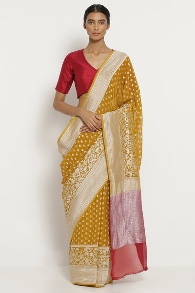 Via East ocher yellow handloom pure silk georgette banarasi saree with all over silver zari motifs