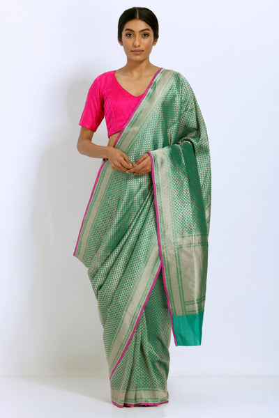 Via East rama green handloom pure silk saree with intricate allover gold zari jali work and rich pallu