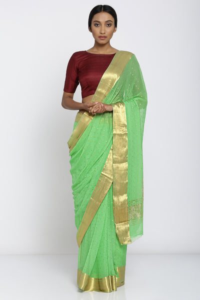 Via East green handloom pure chiffon saree with all over gold motifs and rich border