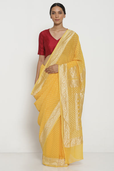 Via East bright yellow handloom pure silk georgette banarasi saree with all over intricate gold zari motifs