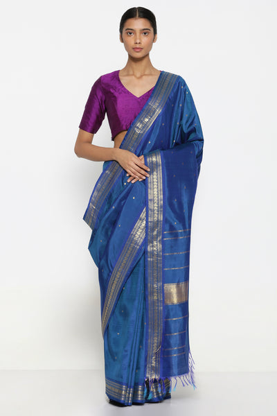 Via East navy blue handloom pure silk kanjeevaram saree with all over zari motifs and traditional peacock zari border