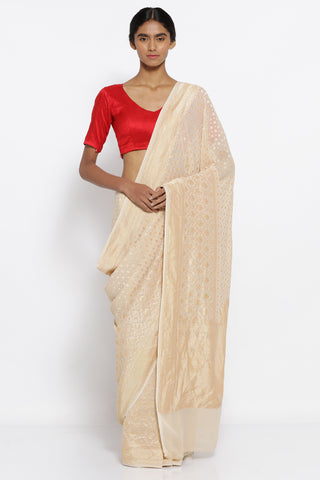 Beige Handloom Pure Georgette Banarasi with all over golden motifs and a rich border