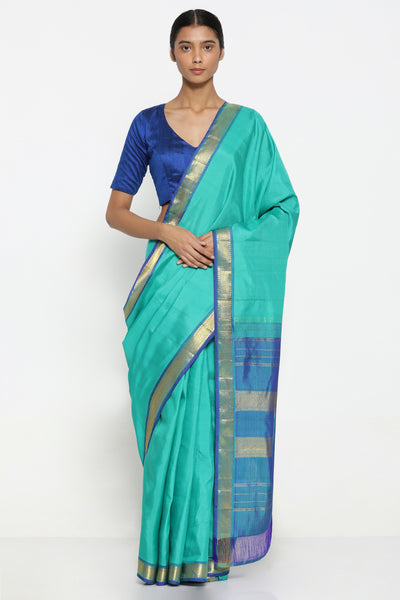 Via East green handloom pure silk kanjeevaram saree with rich detailed zari border