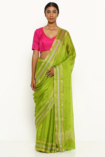 Via East leaf green pure crepe saree with silver and gold zari border