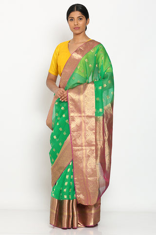 Green Handloom Kora Silk Banarasi Saree with All Over Peacock Zari Motif and Rich Border