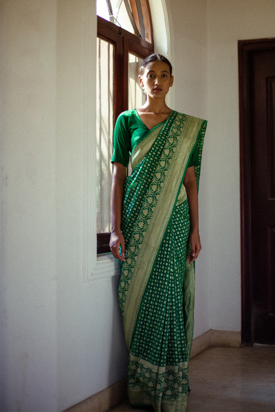 Via East emerald green handloom pure silk banarasi georgette saree with all over gold motifs and a rich detailed border