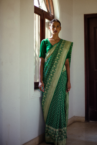 Emerald Green Handloom Pure Silk Banarasi Georgette Saree with All Over Gold Motifs and a Rich Detailed Border