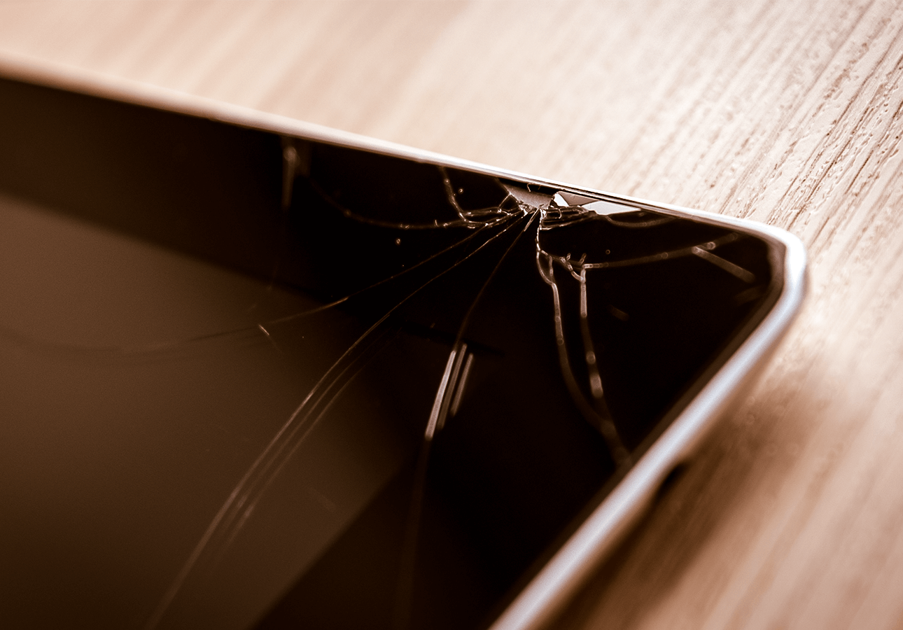 An image of a chipped and broken iPad display.