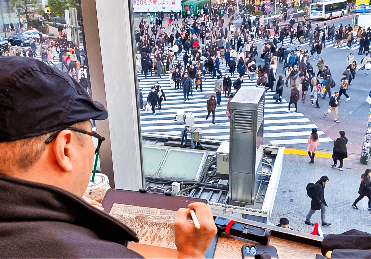 An image depicting Rob Sketcherman drawing on location in downtown Tokyo.