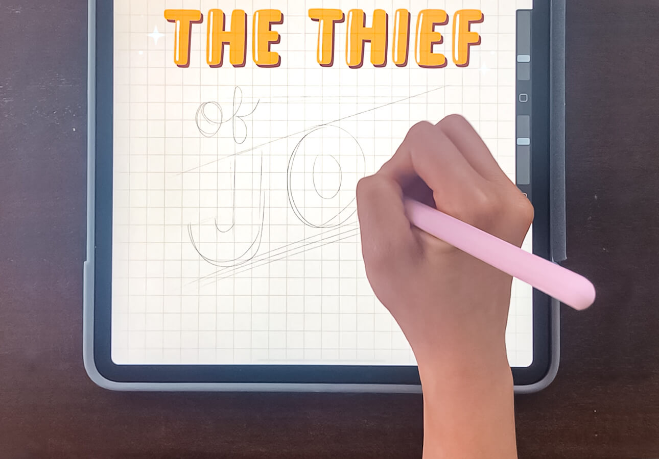 A person working on a hand lettering piece using iPad and Apple Pencil.