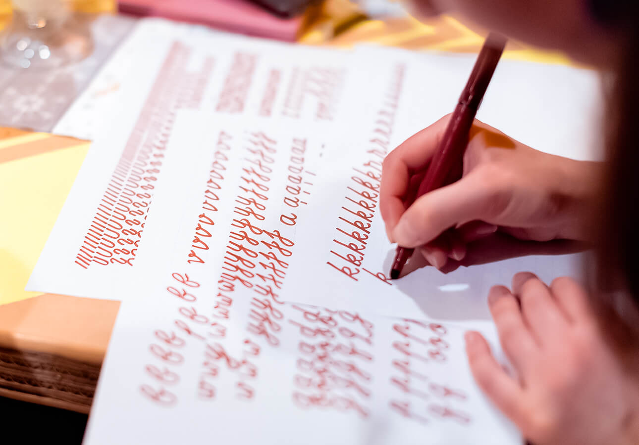 A person working on lettering.