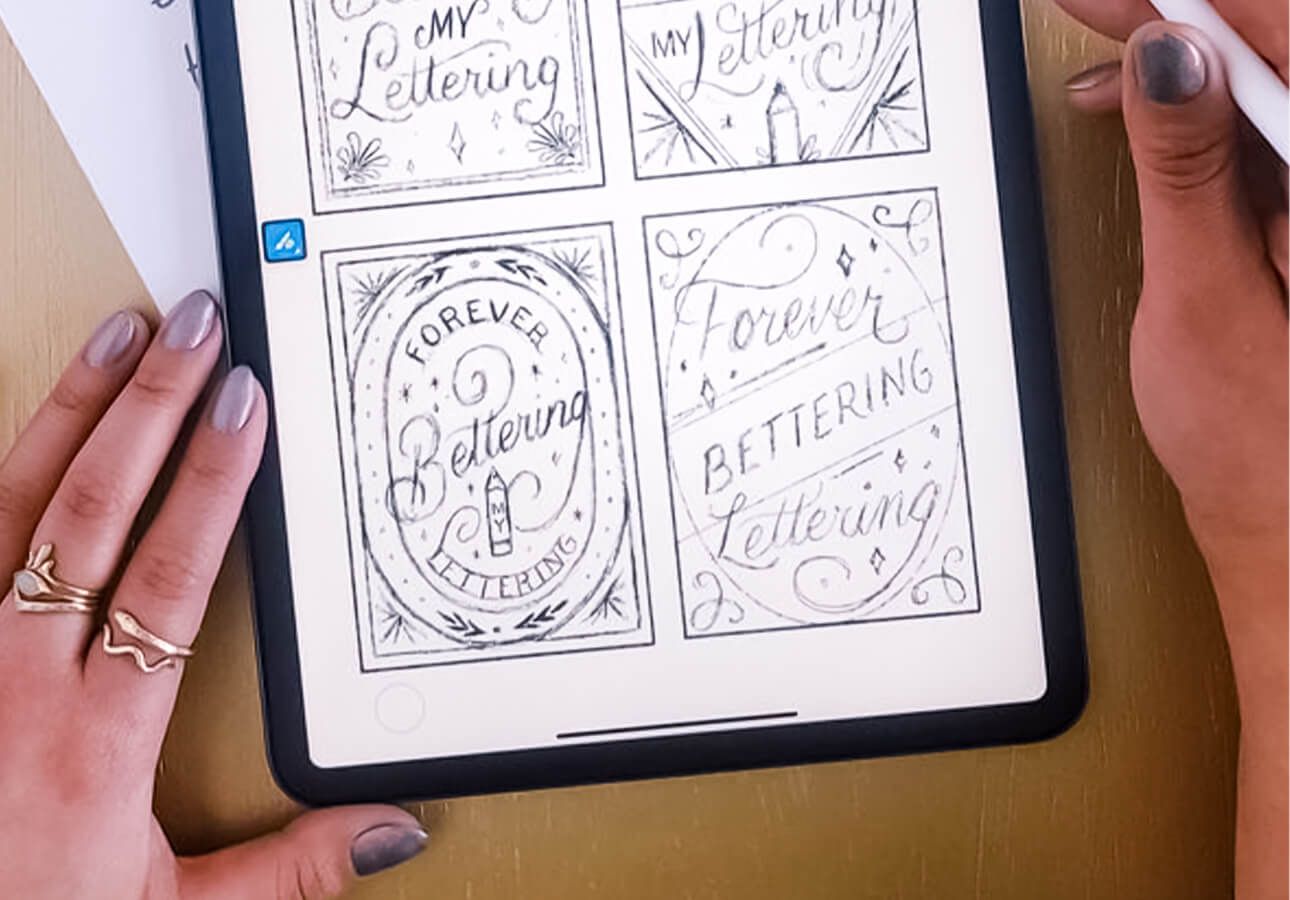 An iPad displaying hand lettering sketches.
