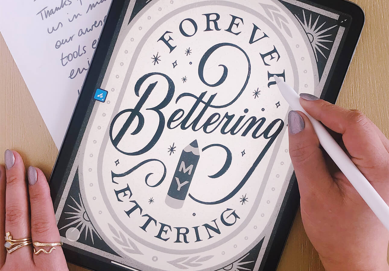 An iPad displaying a vectorized hand lettering piece.