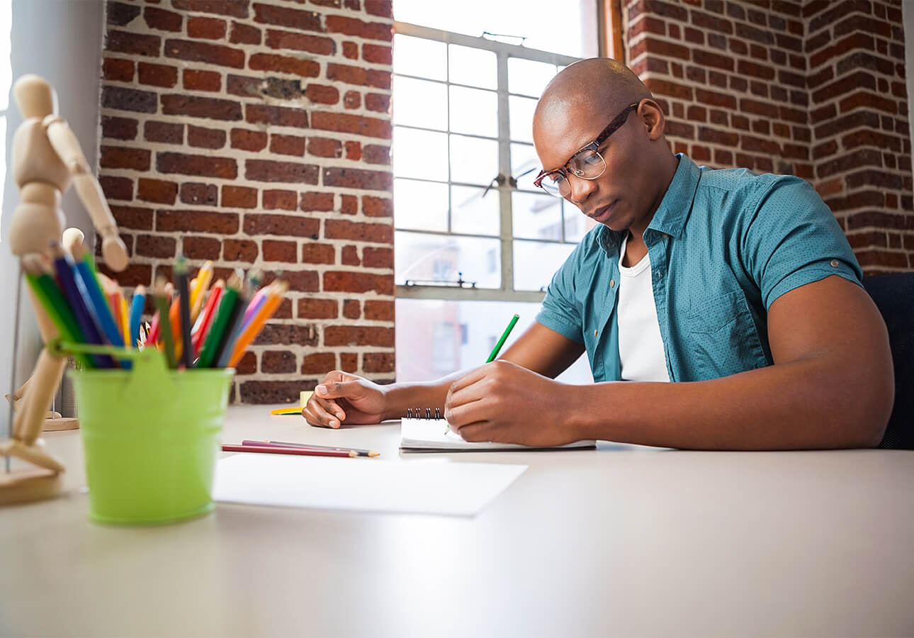 A designer working using pen and paper.