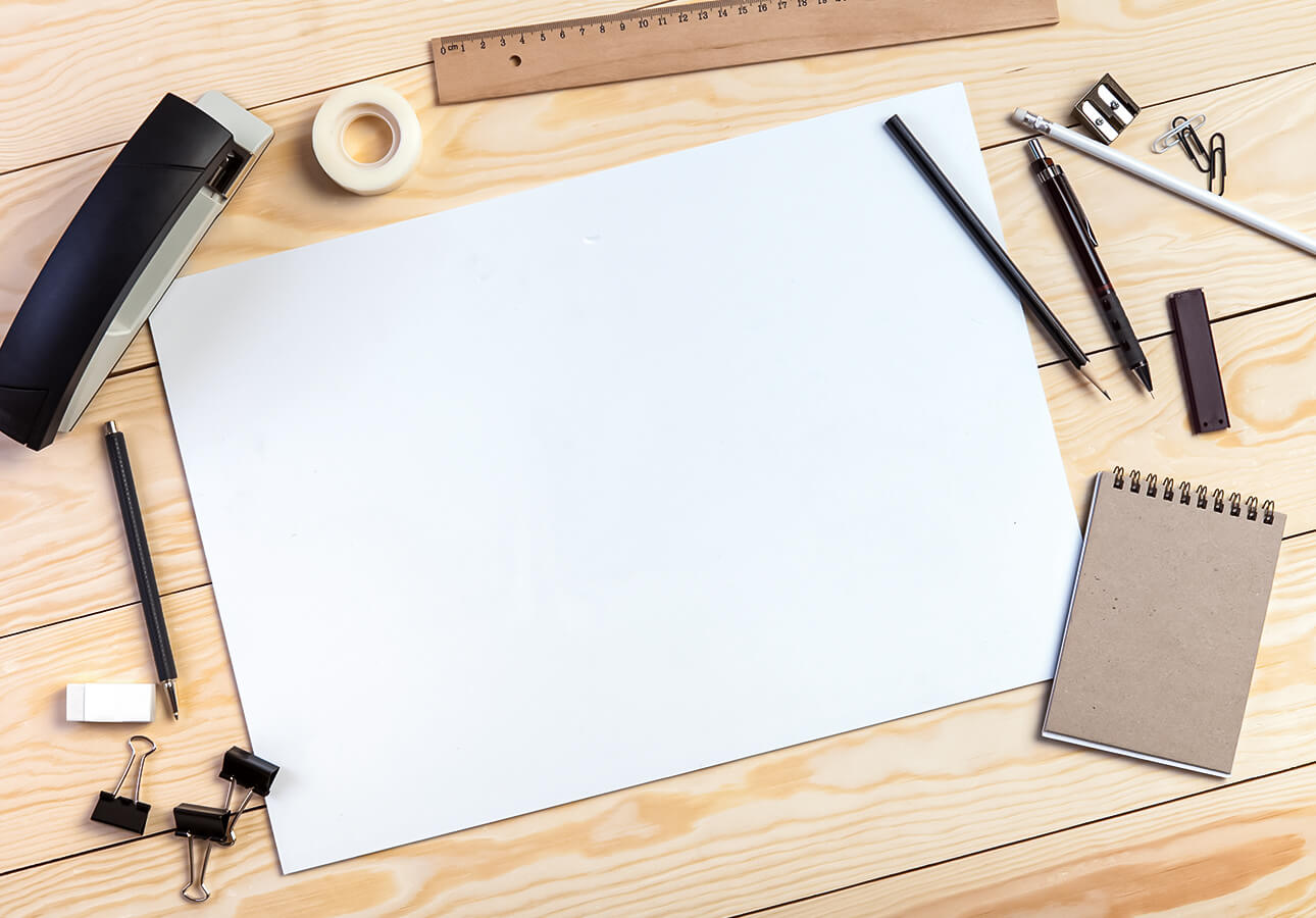 Tools such as paper, pencil, eraser, ruler on a table.
