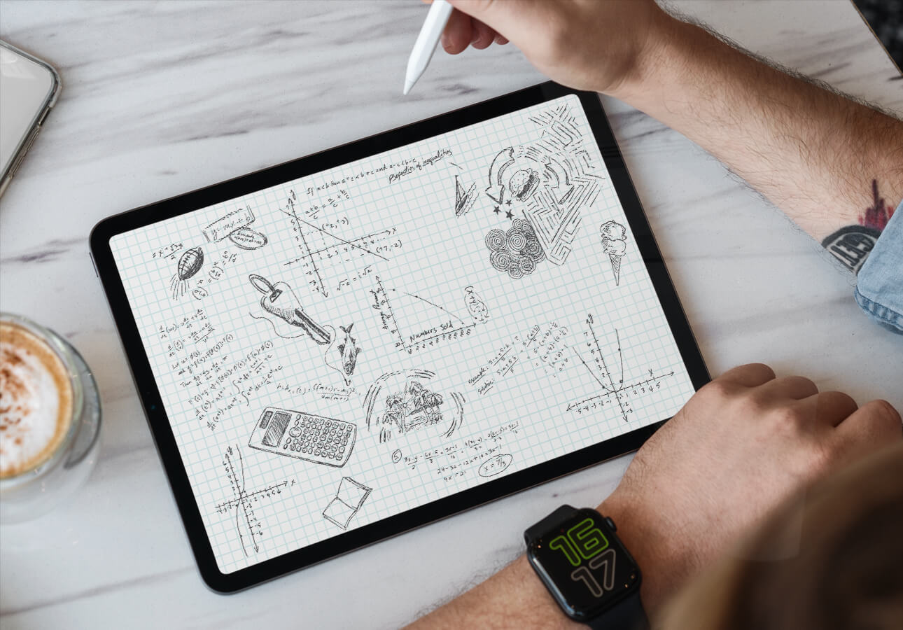A person taking notes and scribbling on iPad.