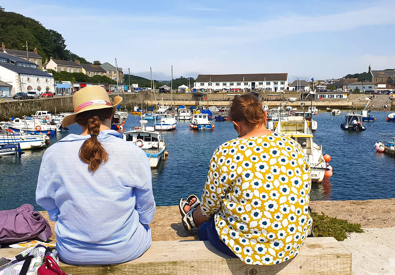 Melanie Chadwick's sketchwalk participants in Porthleven sketching boats.