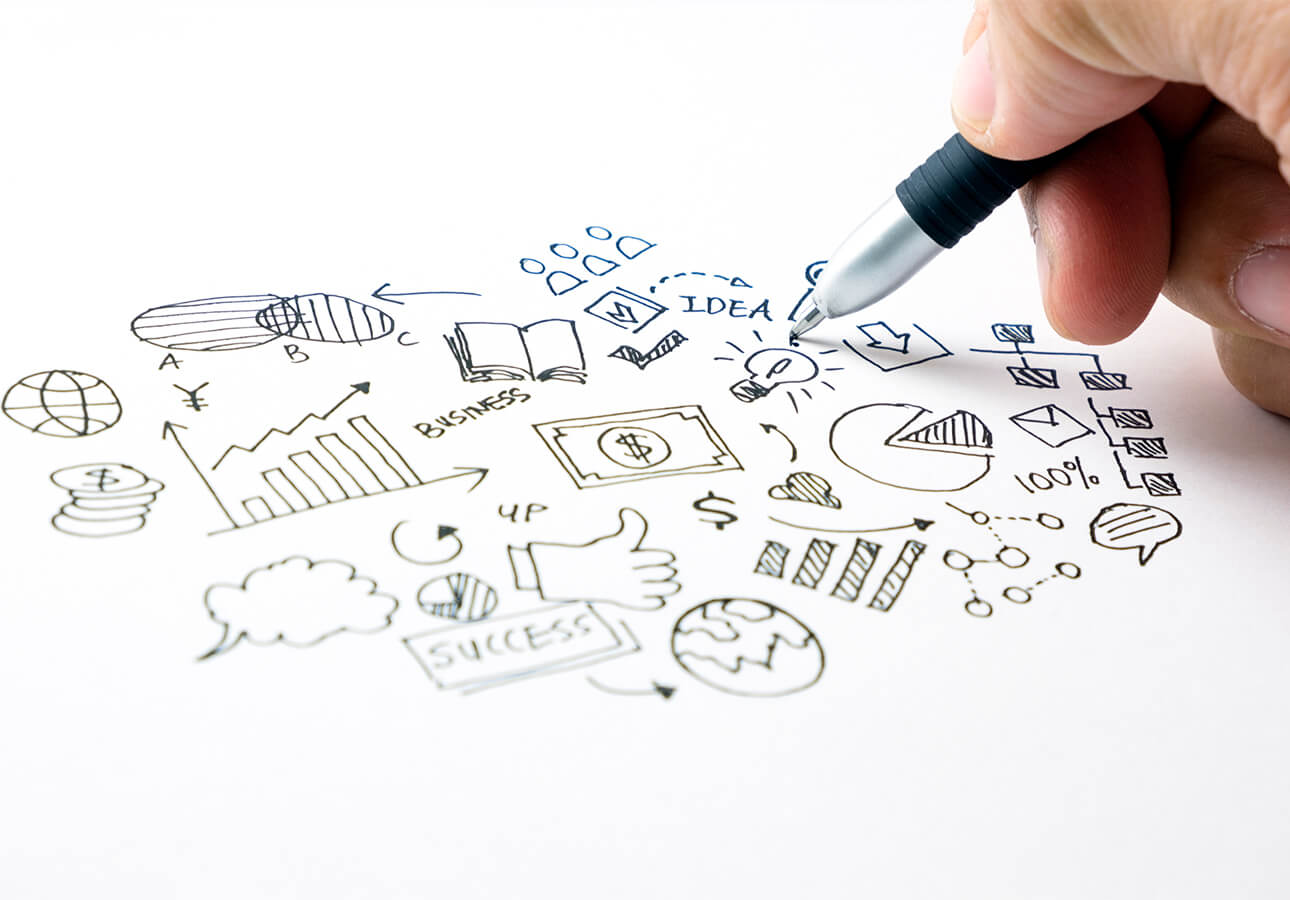 A doodler draws a cluster of business and productivity icons in the shape of a cloud.