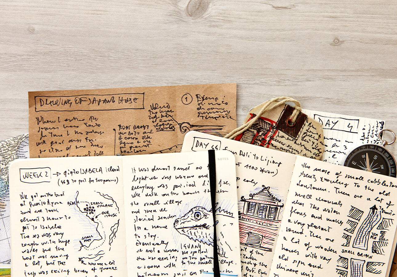An collection of notebooks filled with handwritten notes and accompanying illustrations.