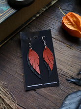 Load image into Gallery viewer, Feather Earrings - Orange and Black - Hammerthreads