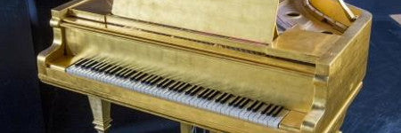 Elvis Presley's gold piano sets new auction record