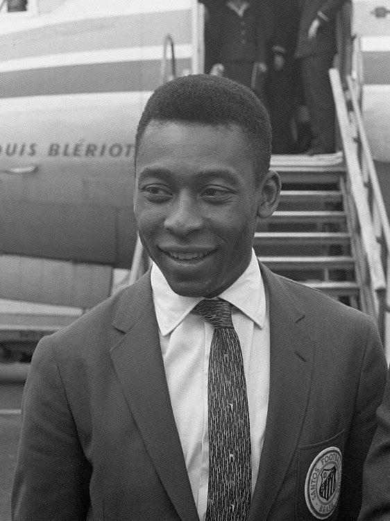 Pele autographs football