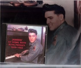 Elvis is at the piano with the guitar tucked away up above