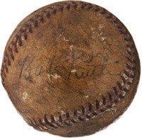 The historic ball, signed by Ruth alongside other illegible autographs