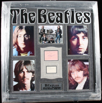 The signed collage features the four Beatles in their later years