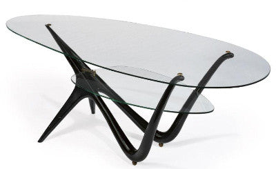 An ebonized wood and glass table by Carlo Mollino ($602.5k)