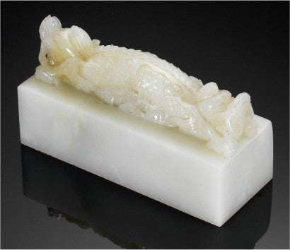 An Imperial white jade`double dragon' seal (£305,600)