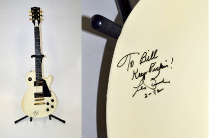 Les Paul ivory electric guitar signed