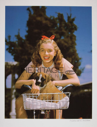 Marilyn Monroe or Norma Jean in a Puppy-in-Basket photo